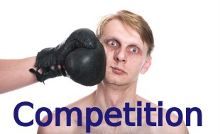 Competition - Man being punched in the face with boxing glove